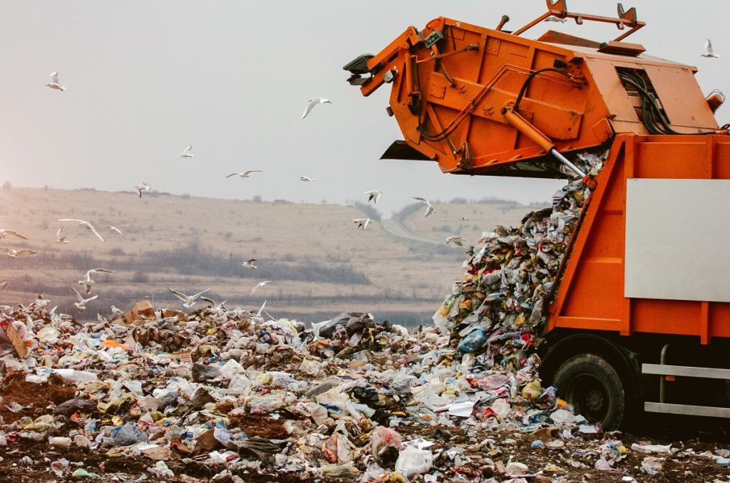 Truck unloading garbage at a landfill