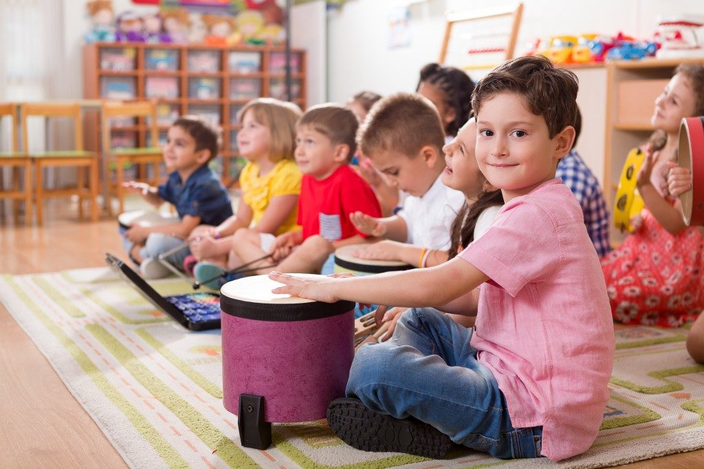 Children in class while holding instruments