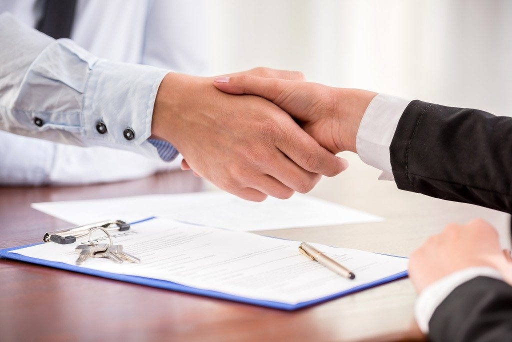 Handshake of a real estate agent and a client