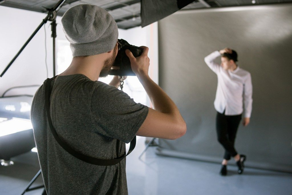 photographer taking photo of the model in the studio