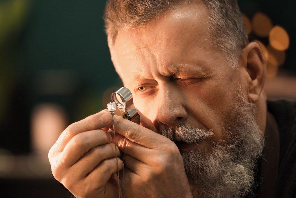 Jeweler evaluating gem