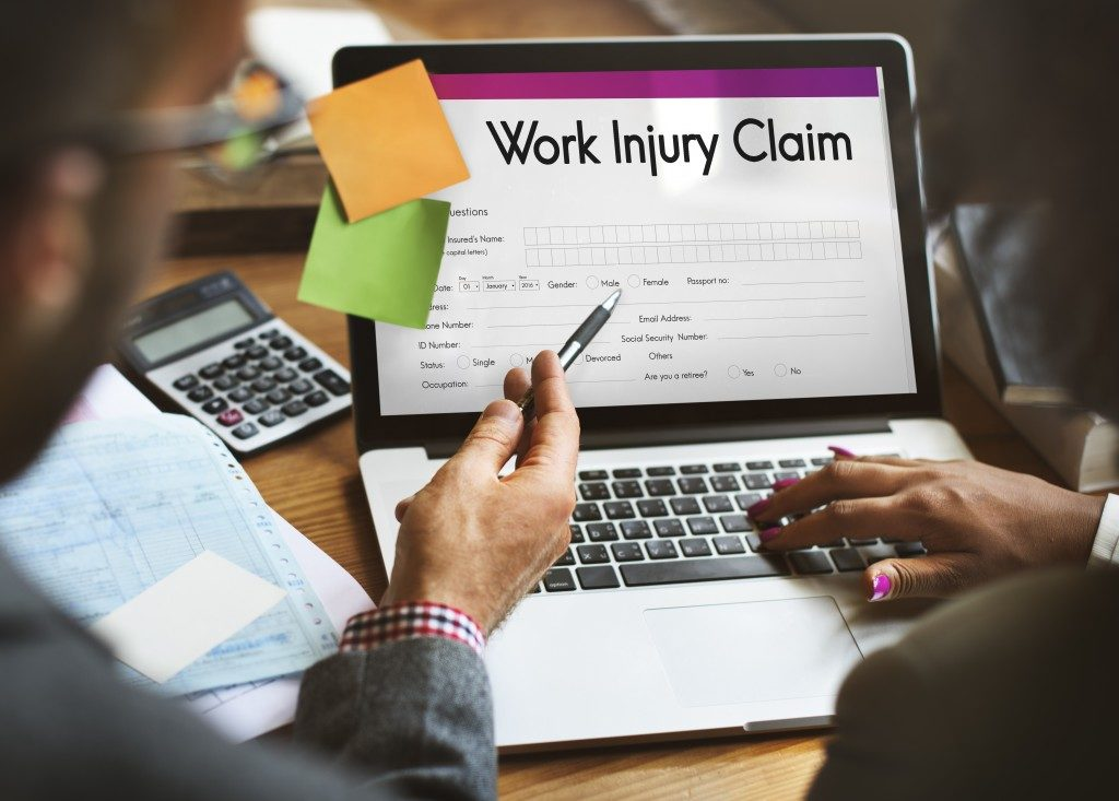work injury claim form reflected on a laptop screen