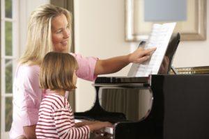kid practising piano