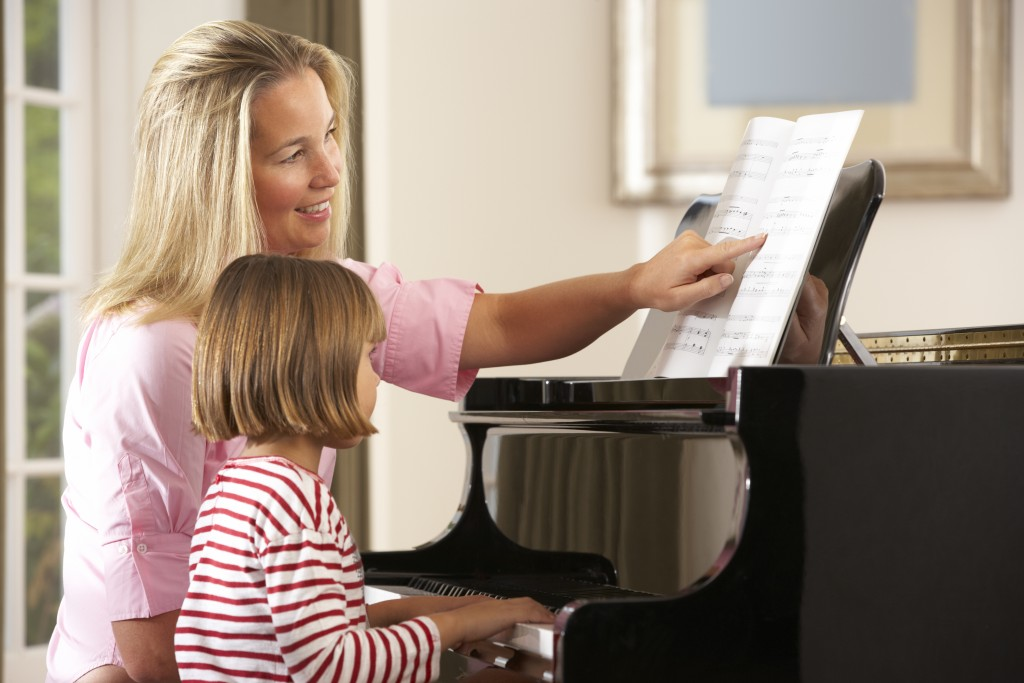 kid practising piano