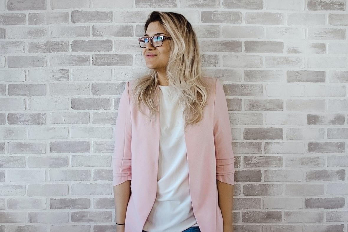 woman in pink cardigan