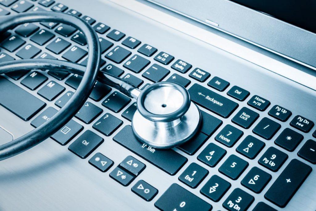 stethoscope on laptop