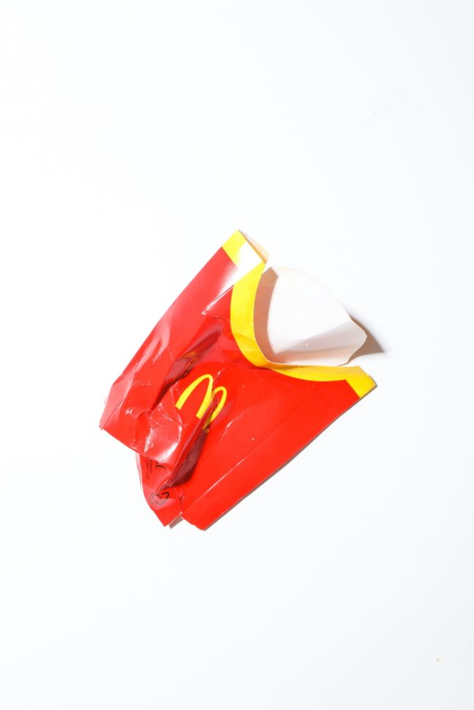 crumpled french fry container